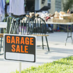 garage sale sign with furniture in the background
