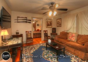 Bonnie & Clyde Themed Living Room with a Sofa, TV, Rug and Side Table