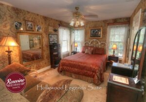 Hollywood Legends room with bed, love seat and dresser with mirror
