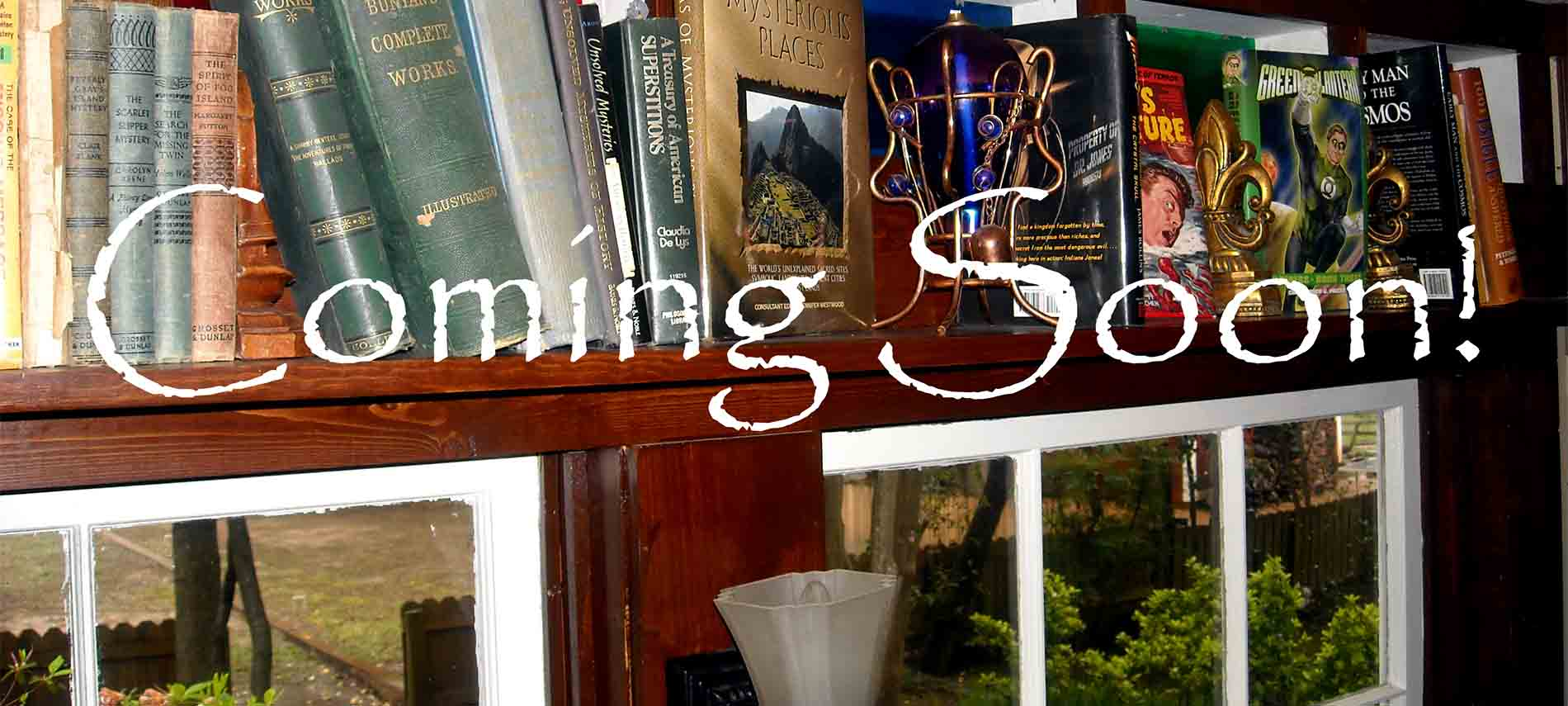 Close-up of antique books on shelf in front of stained glass and above window. Words Coming Soon over all