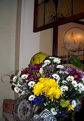 Cheery yellow and purple flowers brighten a nook in the Inn's public area