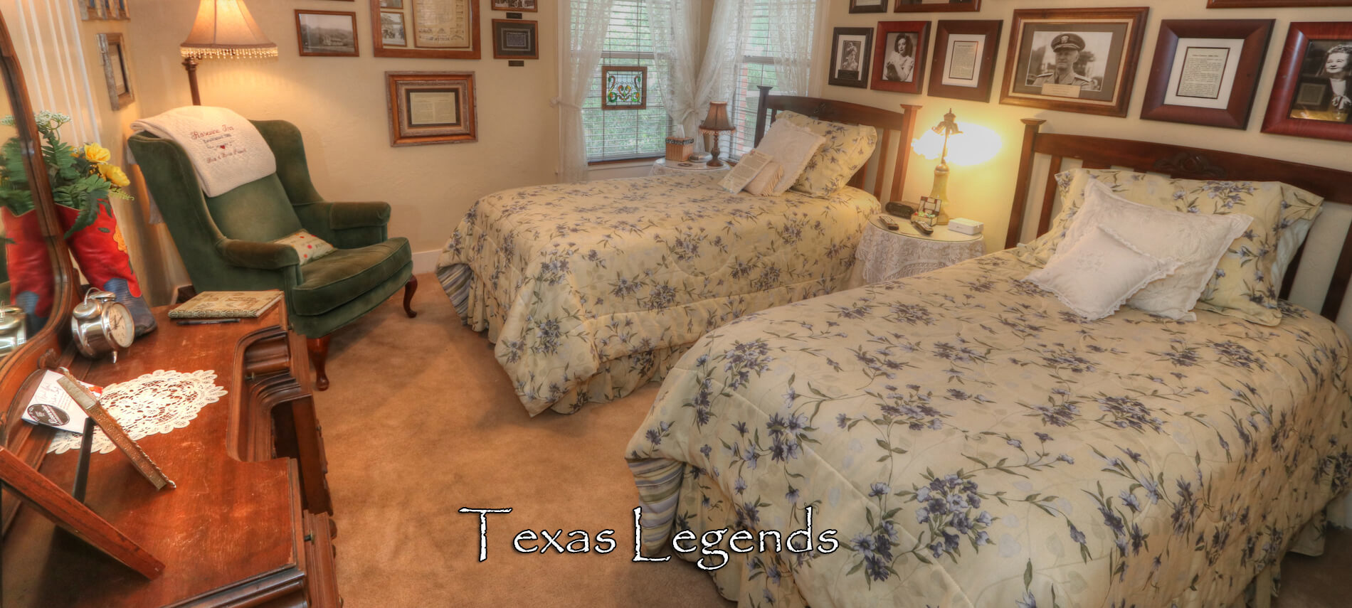 Texas Legends Room with two twin brass beds covered in yellow and blue spreads with nightstand and brass lamps