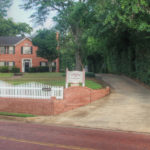Front yard view Rosevine Inn-Red Brick. White picket Fence