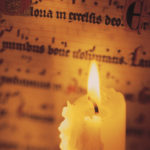 Candle and sheet music