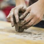 Hands forming clay