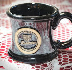 Black coffee cup with Rosevine Inn logo