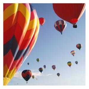 hot air balloons in flight-blue sky