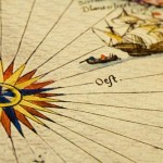 Old map with compass rose and sailing ship