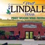 Red brick building with wording Visit Lindale and The piney woods wine festival