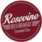 Logo burgandy round says Rosevine Bed and Breakfast Extended Stay